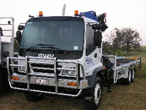 Our 8.2m tray with front mounted crane shifting loads all over Brisbane