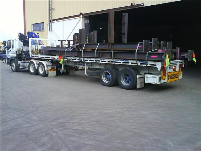 Crane trucks to transport steel beams