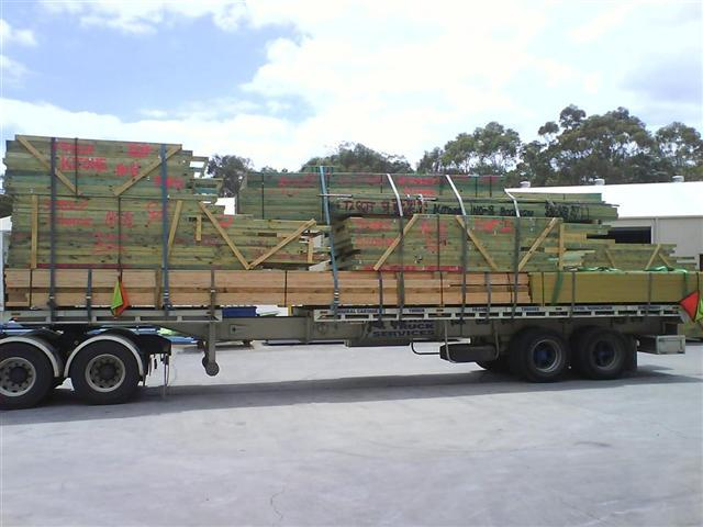 Semi trailer crane truck with an extended trailer
