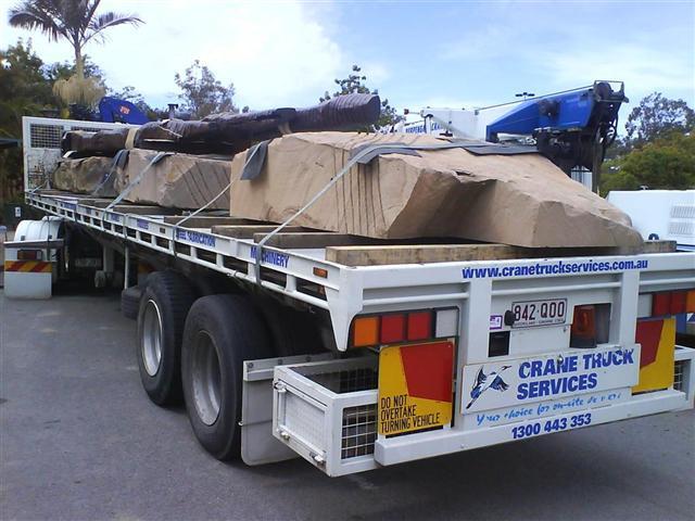 Crane trucks to transport stone walls and blocks