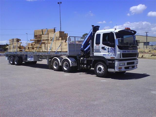Crane trucks to transport timber