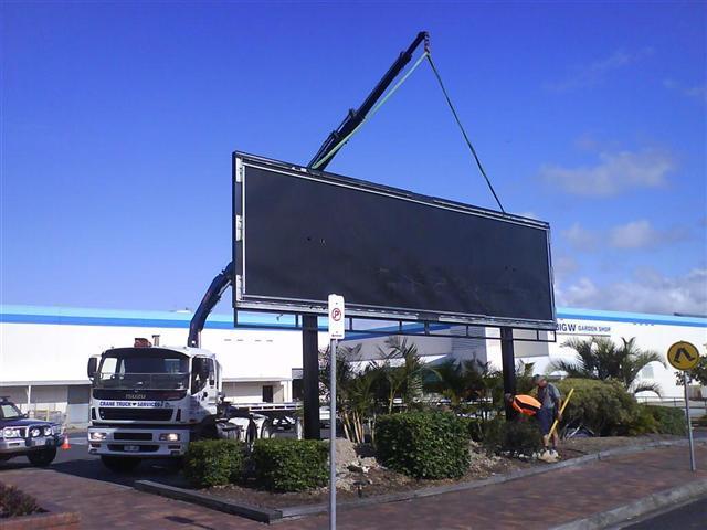 Using Crane Trucks To Lift Signs