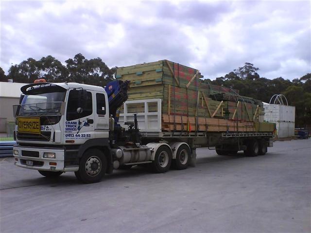 Semi trailer crane trucks carrying an oversized load